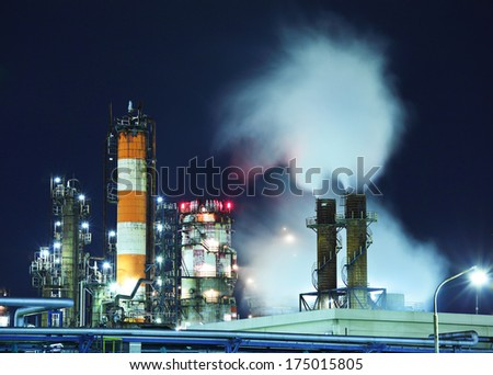 Oil and gas refinery at night - stock photo