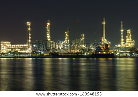 Oil and gas refinery at night time - Petrochemical factory