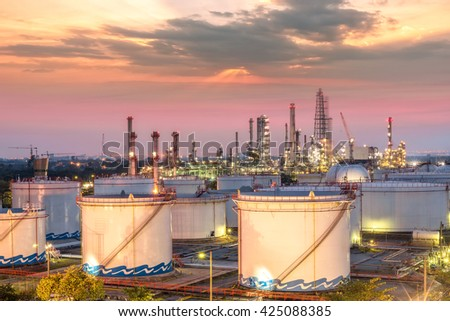 Oil and gas refinery at sunset - factory - petrochemical plant - stock photo