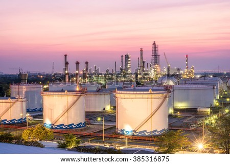 Oil and gas refinery at twilight - stock photo