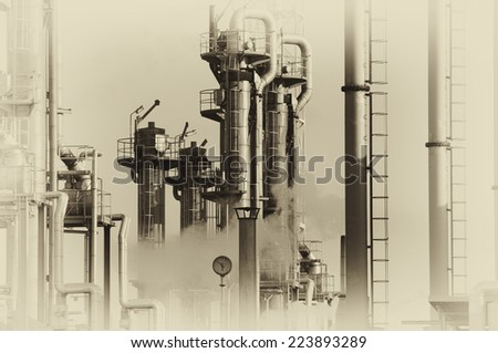 oil and gas refinery in old vintage style of photography - stock photo