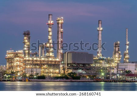 oil and gas refinery petrochemical factory at twilight - stock photo