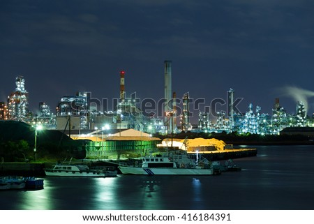 Oil and gas refinery plant at night - stock photo