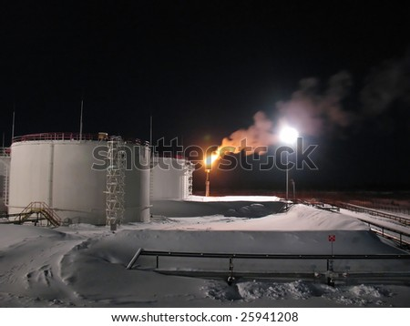 Oil and gas refinery plant. Winter frost. Night scene - stock photo