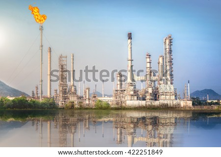 Oil and Gas refinery plant with flare stack, Burning oil gas flare in a large oil refinery, Oil-refinery, Industrial-plant under blue sky, Petrochemical plant. - stock photo