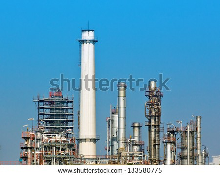 Oil and gas refinery with reflection in water - Petrochemical factory - stock photo
