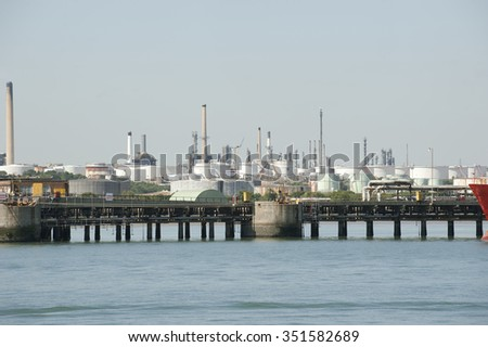 OIL AND GAS STORAGE TANKS ON SOUTHAMPTON WATER SOUTHERN ENGLAND - CIRCA - 2014 - Fawley Refinery on Southampton Water southern England UK