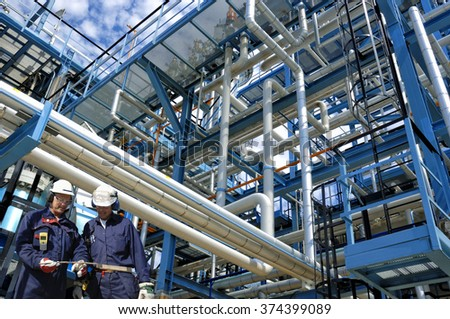 oil and gas workers inside refinery industry - stock photo
