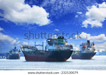 oil and industrial tanker transport ship floating on river port use for industrial freight and logistic business - stock photo