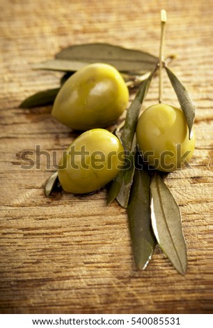 Oil and olives Wood Background