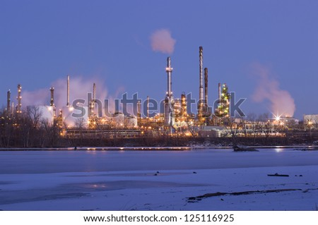 Oil and petroleum refinery along frozen Mississippi River in St. Paul Park Minnesota at night