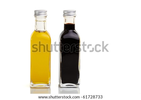 Oil and vinegar bottle duo in nice bottles - stock photo