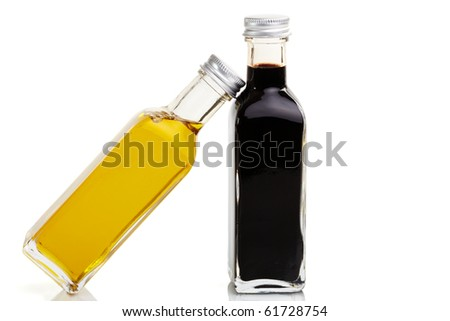Oil bottle leans at a vinegar bottle - stock photo