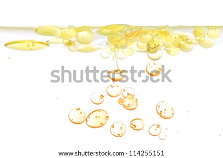 Oil bubbles of oil in water. On a white background. - stock photo