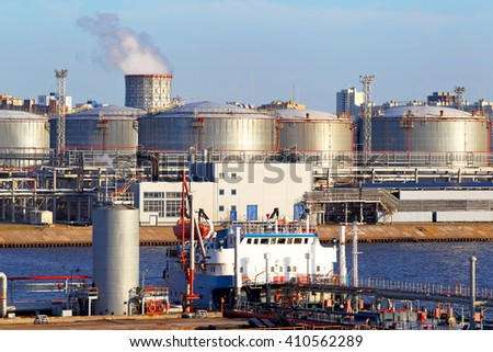 Oil business terminal. The tanker in port. - stock photo