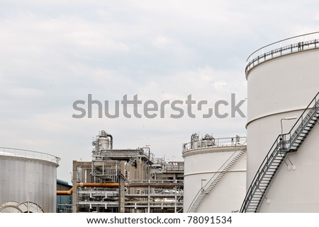 oil depot and storage tanks in rotterdam harbor industry - stock photo