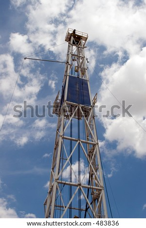 Oil Derrick Against Cloudy Blue Sky