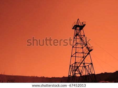 Oil derrick during sunset - Azerbaijan, Baku - stock photo