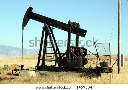 Oil derrick in Kern County #2 - stock photo
