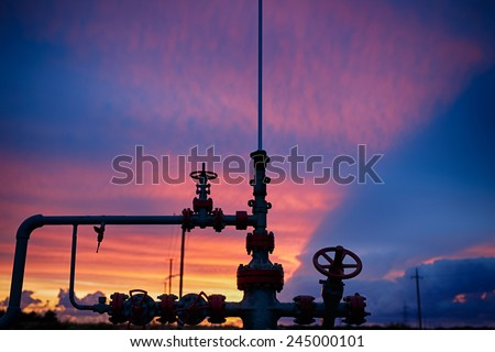 Oil derricks on a background of beautiful sunset, Kaliningrad, Russia - stock photo