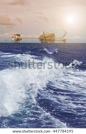 Oil Drill, offshore rig with setting sunlightLens Flare.  - stock photo