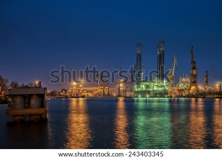 Oil drilling platform for repairs at shipyard in Gdansk, Poland.  - stock photo