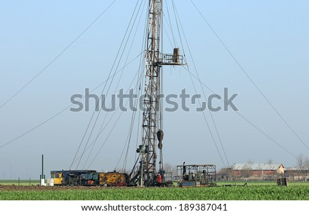 oil drilling rig and workers - stock photo