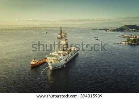 Oil drilling rig ship against panorama of Rio De Janeiro, Brazil - stock photo