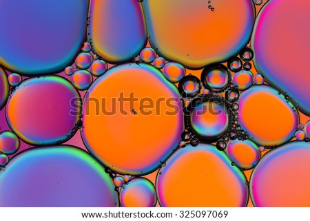 Oil droplets on water - stock photo
