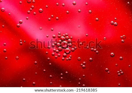 Oil drops on a water surface. - stock photo