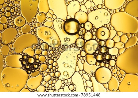 Oil drops on a water surface - stock photo