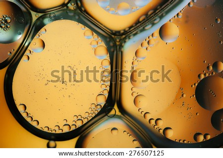Oil drops on a water surface, Orange background - stock photo