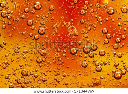 Oil drops on water surface. - stock photo