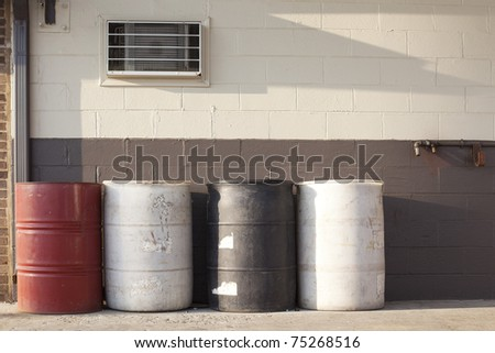 oil drums in garage - stock photo
