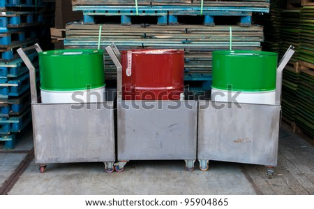 oil drums in leak tanks on wheels - stock photo