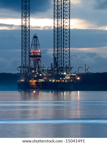 Oil Exploration Rig at Dawn - stock photo