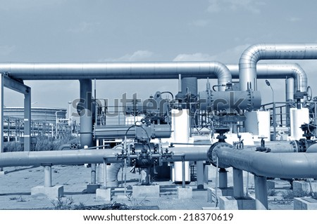 Oil field pipelines and valves  - stock photo