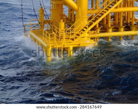 Oil field platform for the oil rig tender when the sea wave crash - stock photo