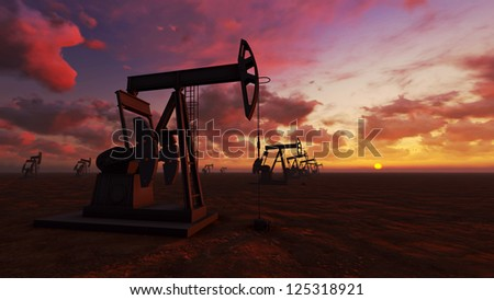 Oil field pump jacks at  sunset - stock photo