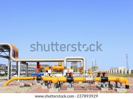 Oil field scene, oilfield equipment at work - stock photo