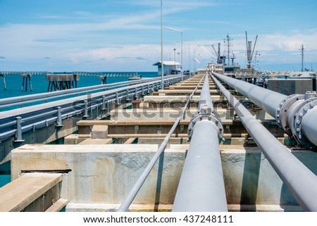 oil fuel pipeline tube on jetty to the sea