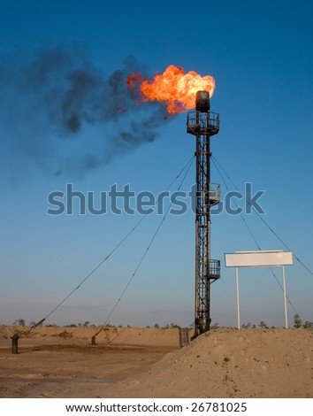 Oil gas flare with sign - stock photo