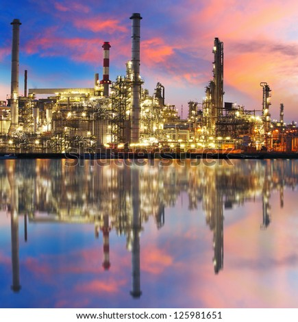 Oil gas refinery with reflection, factory, petrochemical plant - stock photo