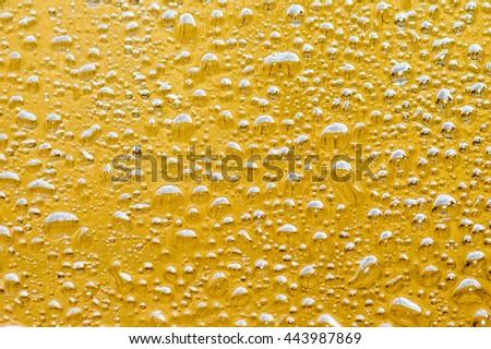 Oil, golden yellow background. - stock photo