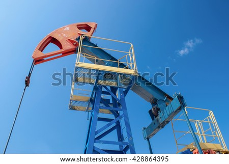Oil industry and gas industry. Work of oil pump jack on a oil field. - stock photo