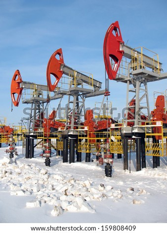 Oil industry and gas industry. Work of oil pump jack on a oil field. Extraction of oil. Oil industry of West Siberia  - stock photo
