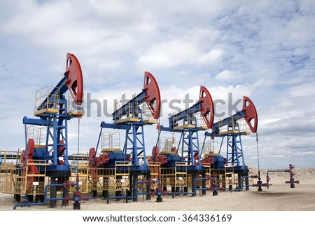 Oil industry and gas industry. Work of oil pump jack on a oil field. Oil equipment - stock photo