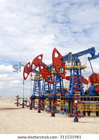 Oil industry equipment. Oil pumps in work. - stock photo