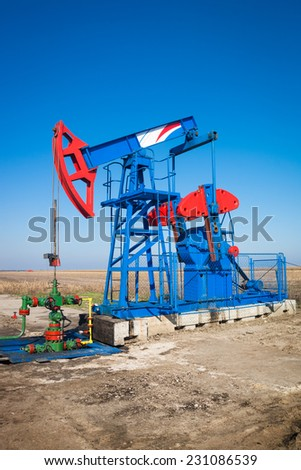 Oil industry pump jack close up - stock photo