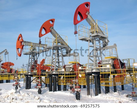 Oil industry. Pump jacks in work - stock photo